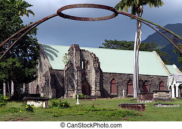 Iron halo over stone church and cemetery in St Kitts - Old...