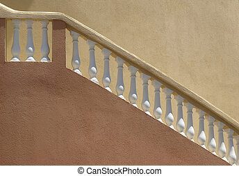 Plaster balustrade railing and stucco wall - Warm colors on...