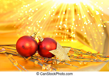 Christmas red baubles on the yellow blured background