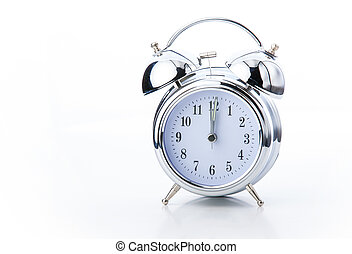 old fashioned alarm clock on white backgrounds