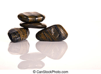 FIVE STACKED BROWN SPA PEBBLES