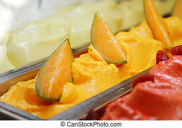 sweet cold tasty appetizing melon ice cream in metal basket