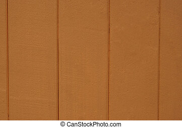 Texture of orange wooden fence close-up