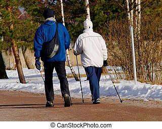Walking people - A couple of people using Finnish invention...