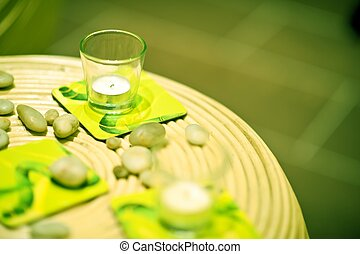 Green Home Decoration. Wattle Table, Small Glass Candles and...