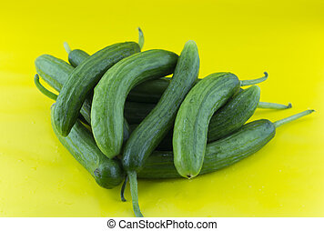 Fresh Cucumber on yellow background