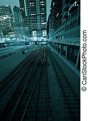 Train Tracks. Downtown Chicago by Night. Vertical Photo