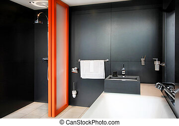 Black bathroom - Bathroom all in black with orange divider