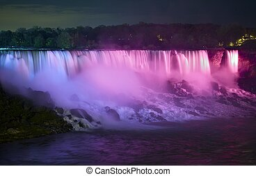 Niagara Falls at Night. Illuminated Waters of Niagara Falls....