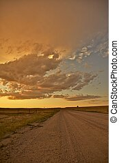 Country Road. Great American Plains Road at Sunset. Vertical...