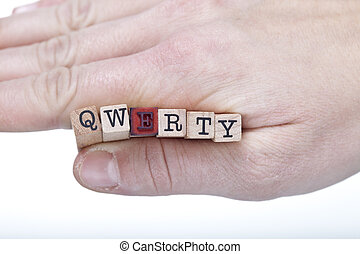 hand with QWERTY letters - woman holding qwerty combination...