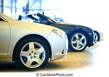 Dealership Showroom. Three Cars in the Showroom. Vehicles...