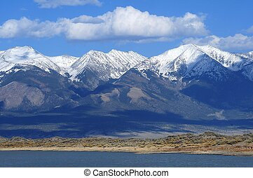 San Luis Lake and snowy Rocky Mountains - Colorado USA