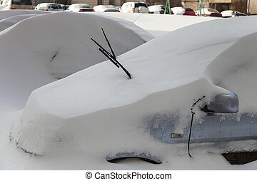 Cars covered in snow