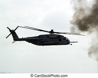 Combat helicopter on battle - US combat helicopter mid-air...