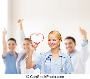smiling doctor or nurse drawing red heart - healthcare,...