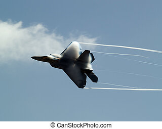 F-22 rapid turn - F-22 Raptor turns rapidly having contrail...