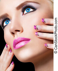 Beautiful blonde girl with pink lips and nails on black...