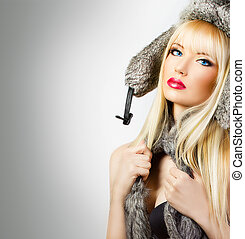 Beautiful blonde girl in fur hat