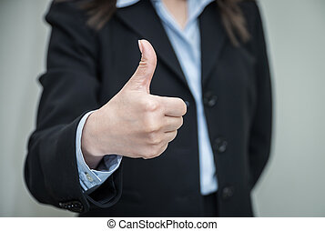 Woman giving thumbs up