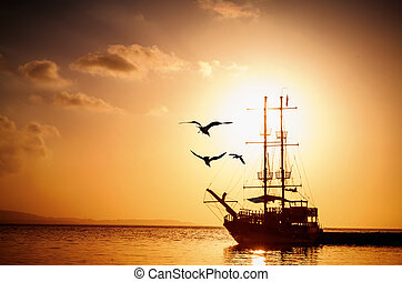 Ship silhouette at sunset