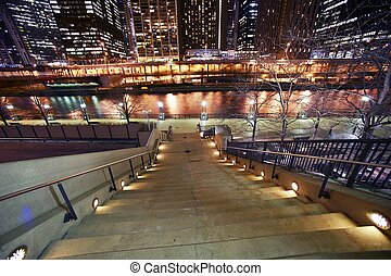 Stairs to Riverwalk in Chicago, IL USA. Chicago River and...