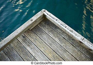 Wood Dock Corner and Crystal Clear Dark Blue Water.