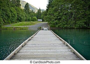 Wood Boat Dock on Lake Crescent, Washington State, USA. Dark...