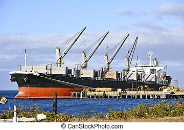 Commercial Ship with Cranes Sea Transportation and Logistics...