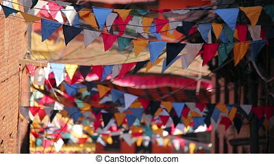 Prayer flags over streets of Kathmandu, Nepal - Buddhist...