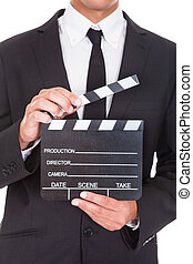 Businessman Holding Clapper Board - Close-up Of A...