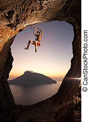 Rock climber falling a cliff while lead climbing - Rock...