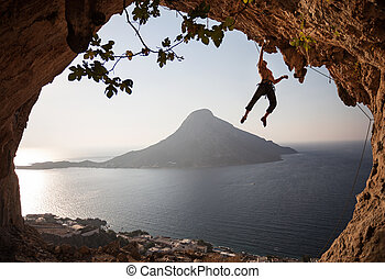 Rock climber at sunset Kalymnos, Greece - Rock climber at...