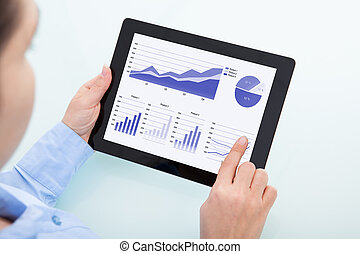 Businesswoman Using Digital Tablet - Close-up Of...