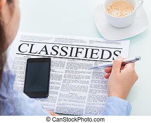 Businesswoman Reading Classifieds - Close-up Of A...