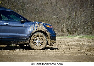 Dirty Off-Road Driving. Super Dirty Modern SUV. Off-Road...