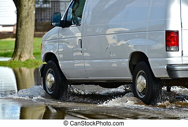 Flooded Street. Van Driving Thru Flooded Street. Flood Photo...