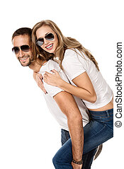 having fun - Happy young couple in love posing at studio....