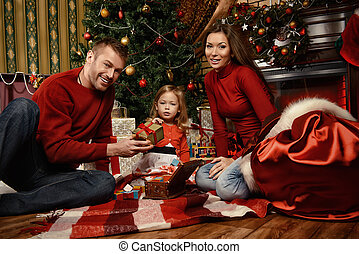 family event - Happy family celebrating Christmas at home by...