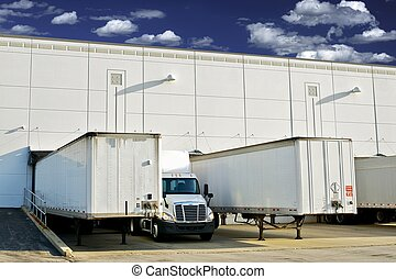 Warehouse Loading Docks - Business District. Semi Trucks and...