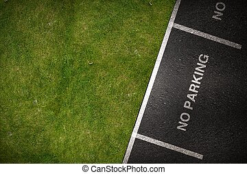 No Parking Spots - Top View Pavement and Grassy Field