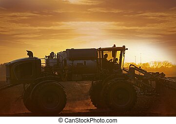 Tractor on the Corn Field in Sunset Illinois, USA...