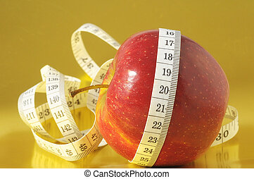 Diet Apple - Measuring Tape Wrapped Around a Red Apple as...