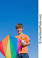 Boy Flying a Kite - A Boy Flying His Kite Against a Blue Sky
