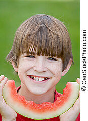 Boy Eating Watermelon - Handsome Boy Eating Slice of...