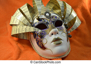 Carnival mask with orange background