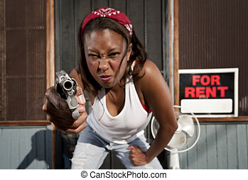 Woman with Gun - African American woman with a gun on her...