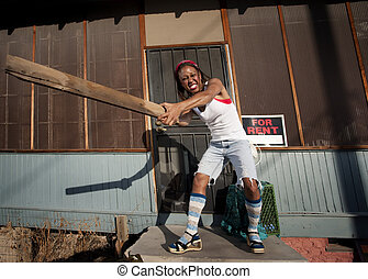 Woman swinging a board - African American woman swinging a...