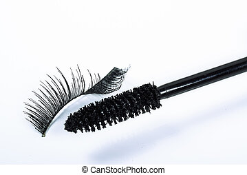 bent false eyelash and a mascara brush - One bent false...