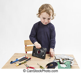 computer parts on wooden desk - preschooler with computer...